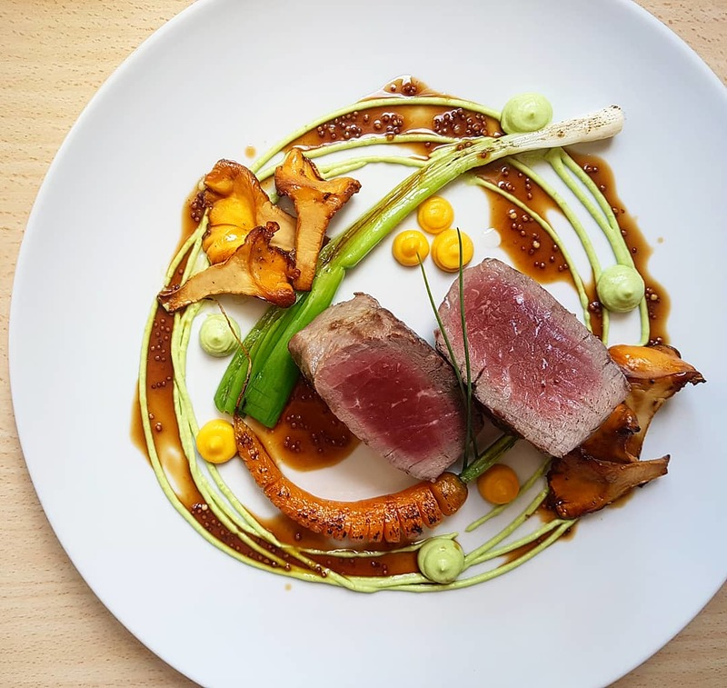 Grilled beef tenderloin•pea/leek puree•chanterelles•haselback carrot•spring onion•mustard seeds beef jus..