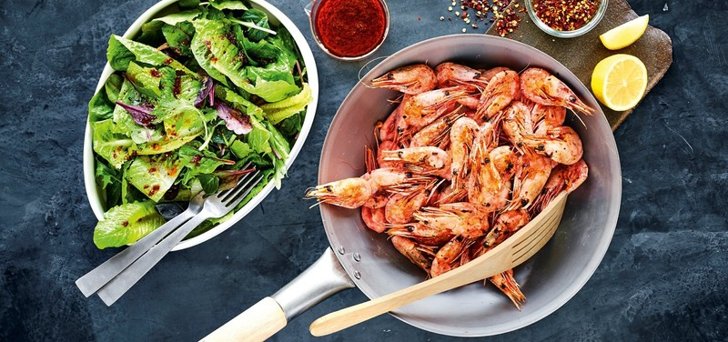 Wok-fried prawns with chili and a green salad