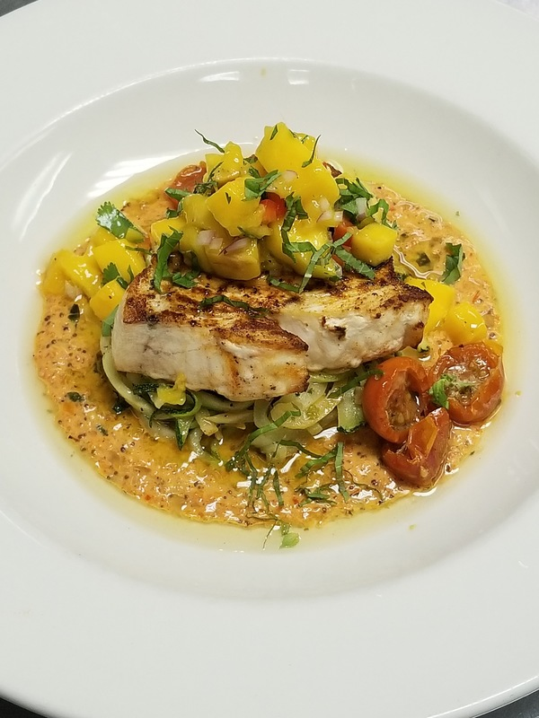 Seared Swordfish, Summer Squash Noodles, Mango Salsa, Red Pepper Cream Sauce, Basil oil.