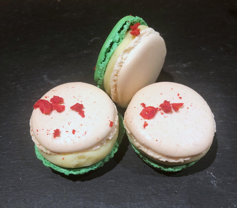 Strawberry and wasabi macarons.