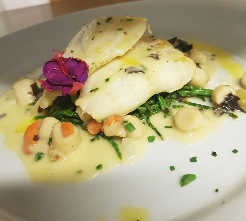 Lemon sole with samphire ,with a queen scallop and dulse sauce and lemon oil
