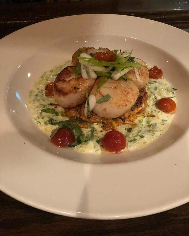 Seared Scallops, Sweet Potato Cake, Green Onion Cream Sauce.
