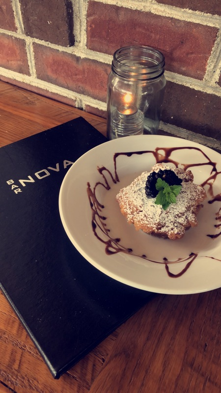 Black cherry bread pudding,dusted in powdered sugar served in warm milk
