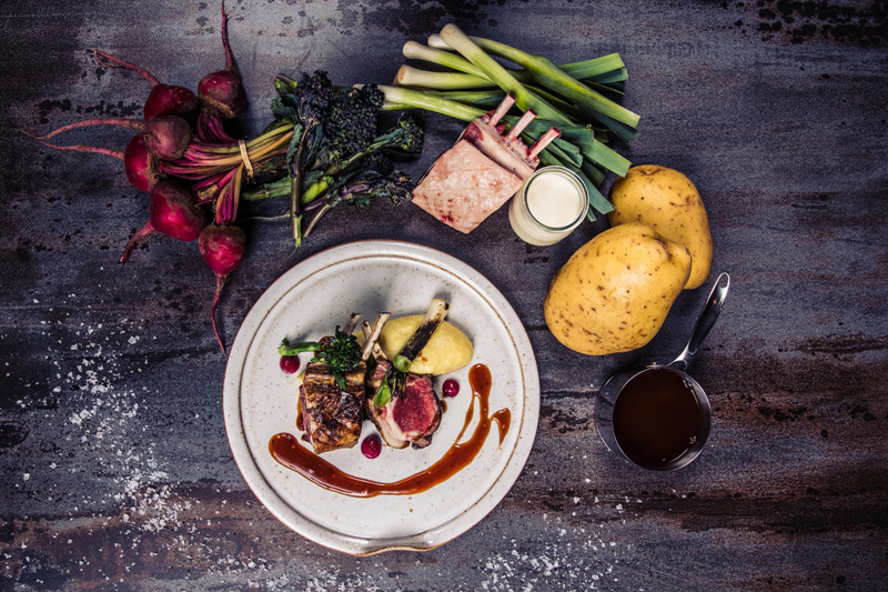 Rack of Lamb recipe with creamed potatoes, burnt leeks, beetroot puree and purple broccoli by Thomas Rhodes