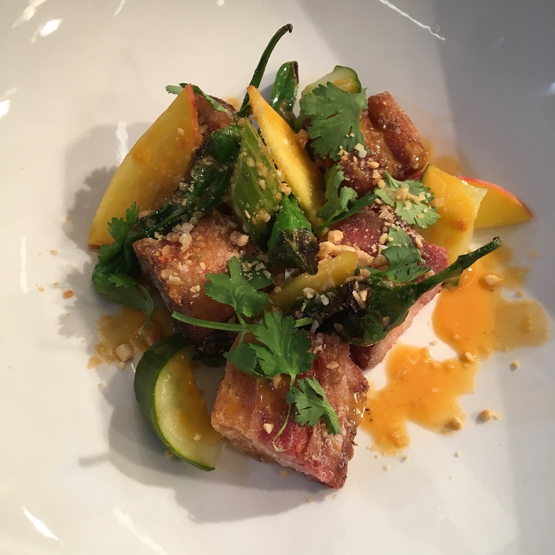 Crispy pork belly/Michigan peaches/cucumbers/shishito peppers/tahini vinaigrette/nuoc Cham/cilantro/coconut peanut crunch