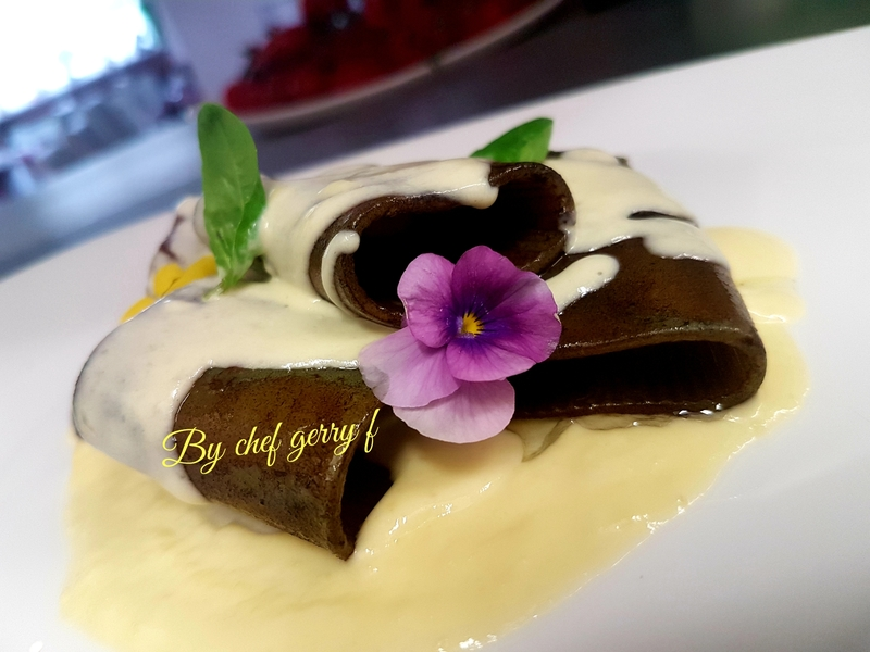 Black ink Paccheri with cream of parmessan cheese