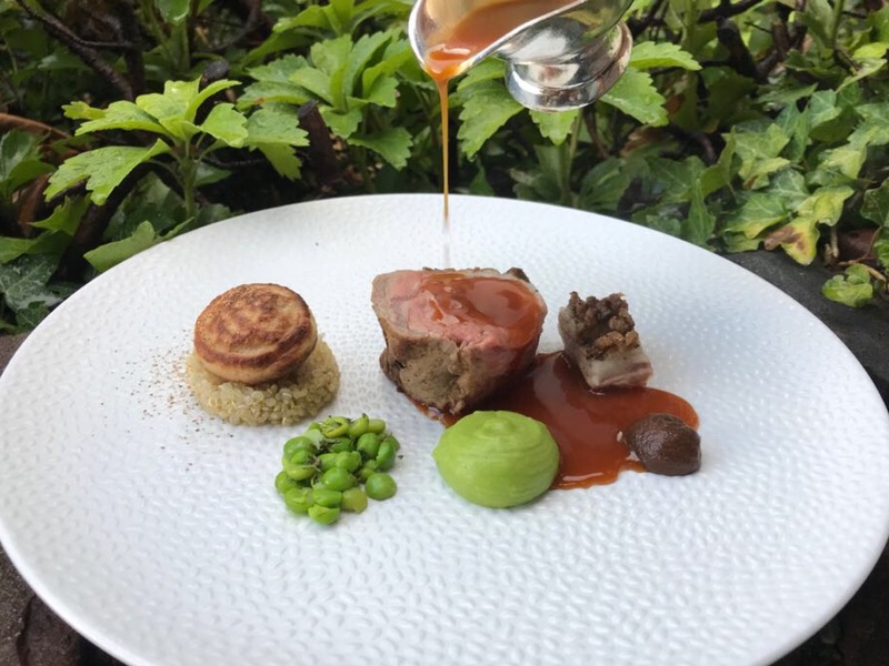 "Irish Lamb roasted on the Bone, Organic Green Peas with Home Grown Savory, Lovage, Fermented Garlic, Quinoa, Confit of Belly Bacon, ""Poffertje"" with Kidney Pie, Lamb Jus"