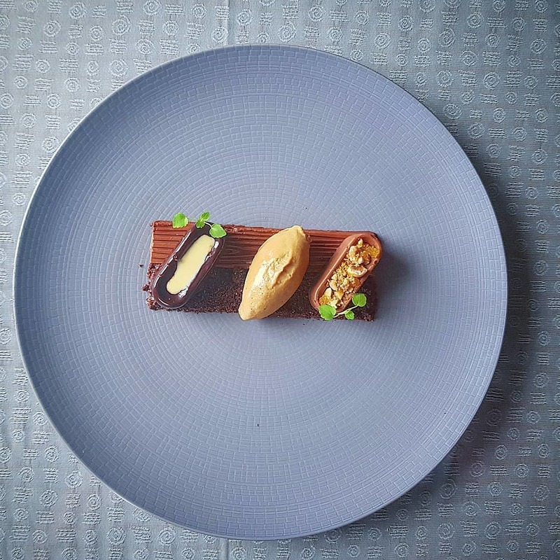 Chocolate and hazelnut delice. Praline mousse, chocolate soil, brown butter and hazelnut ice cream.