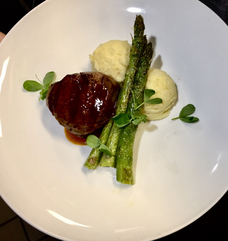 Filet tenderloin , herb whipped potatoes, asparagus, beef reduction