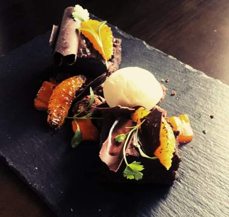 """chocolate and orange"" brownie, orange jelly, charred orange, chocolate bark and soil, vanilla ice cream."