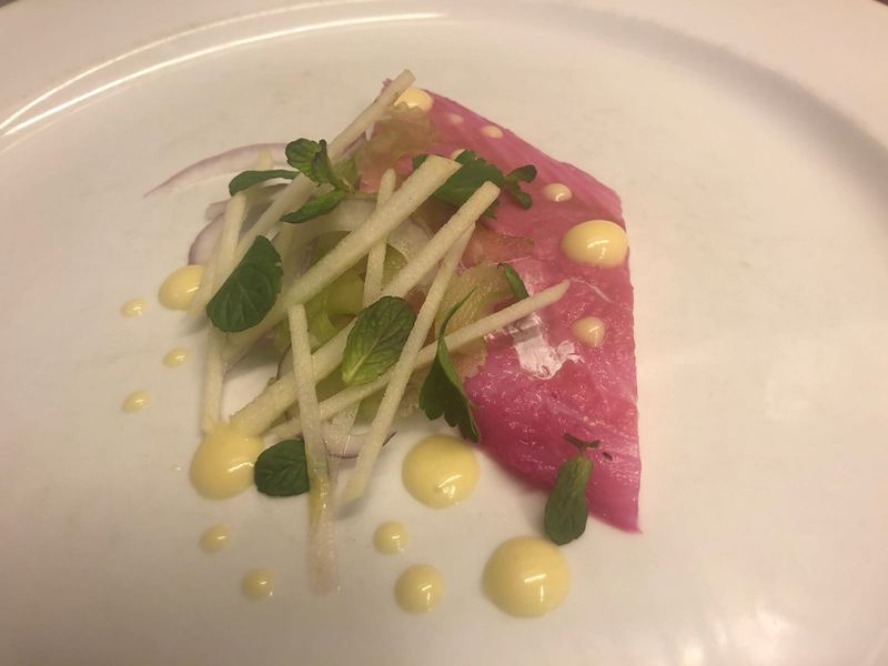 Pickled hake, green apple, celery, anchovy and garlic emulsion, thin onion.