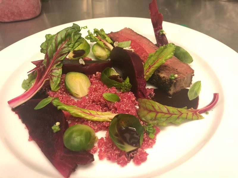 Flank steak, brussel sprouts, quinoa, baked beets, red wine dark chocolate rosemary sauce.