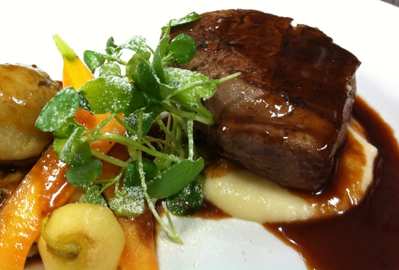 Fillet of Beef, mini braised pudding, Colcannon, roots, braising gravy