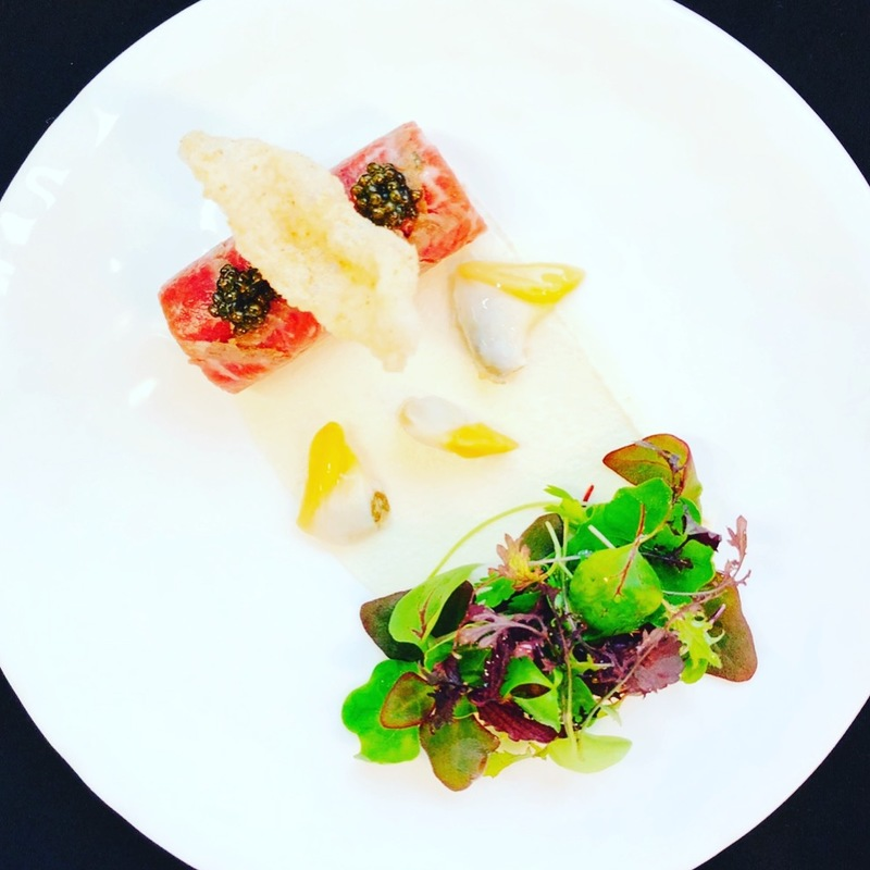 'Surf 'n Turf' Beef tenderloin and oyster tartare wrapped in marinated-seared beef ribeye carpaccio, caviar,  pickled Manila clams, toasted almond purée, beef tendon puff with dried scallop (convoy) powder, herbs