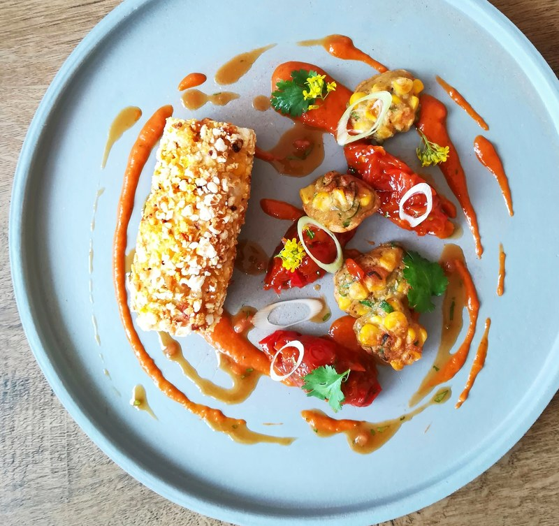 Popcorn chicken roulade, sweet&sour peppers, sweetcorn fritters, spicy tomato&coriander puree.