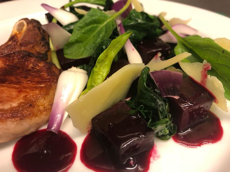 Pork chop, beets in red wine and rosemary reduction, spinach, pickled red onions, pecorino cheese.