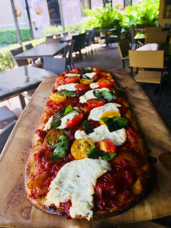 House made flatbread dough, San marzano tomatoes sauce, house made ricotta cheese, heirloom tomatoes, fresh basil