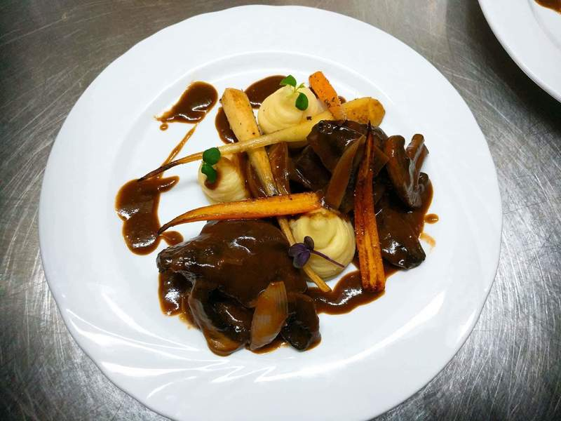 Braised cheek of beef with shallots and button mushrooms.  Potato and celeriac puree.  Lightly roasted baby carrots and parsnip.  Jus