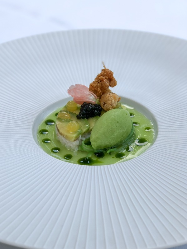 Appetizer at restaurant de Bokkedoorns** Crab salad, marinated and ice cream of haricot, crispy chipirones and avocado