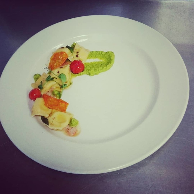 Ricotta and parmesan agnilotti, courgette and basil puree, confit tomatoes and deep fry tomato skin
