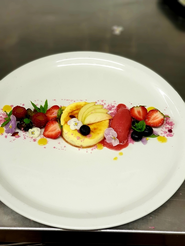 Creme bruleé with fruits,blackcurrant sauce raspberry sorbet and raspberry crumb!:fork_knife_plate: