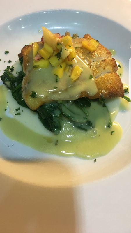 Goat cheese n  potato puree, braised spinach,  pan seared snapper,  and a jalapeno mango beurre blanc