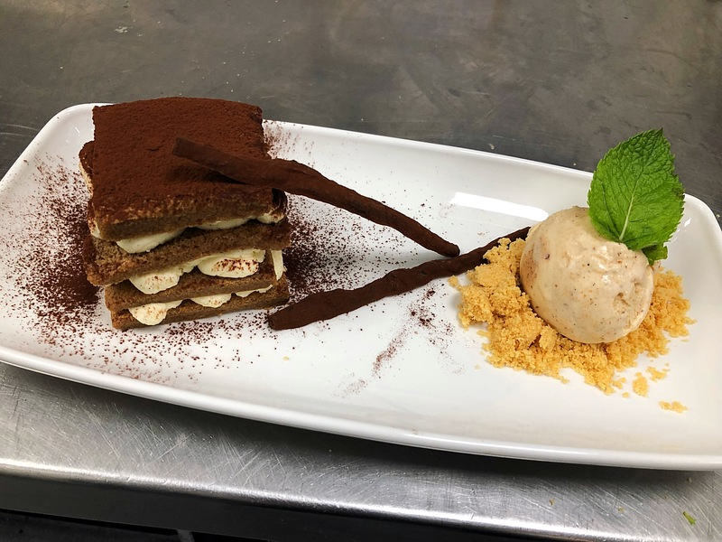 Tiramisù, chocolate sticks with Amaretto Ice Cream on a Sand of Shortbread Biscuits