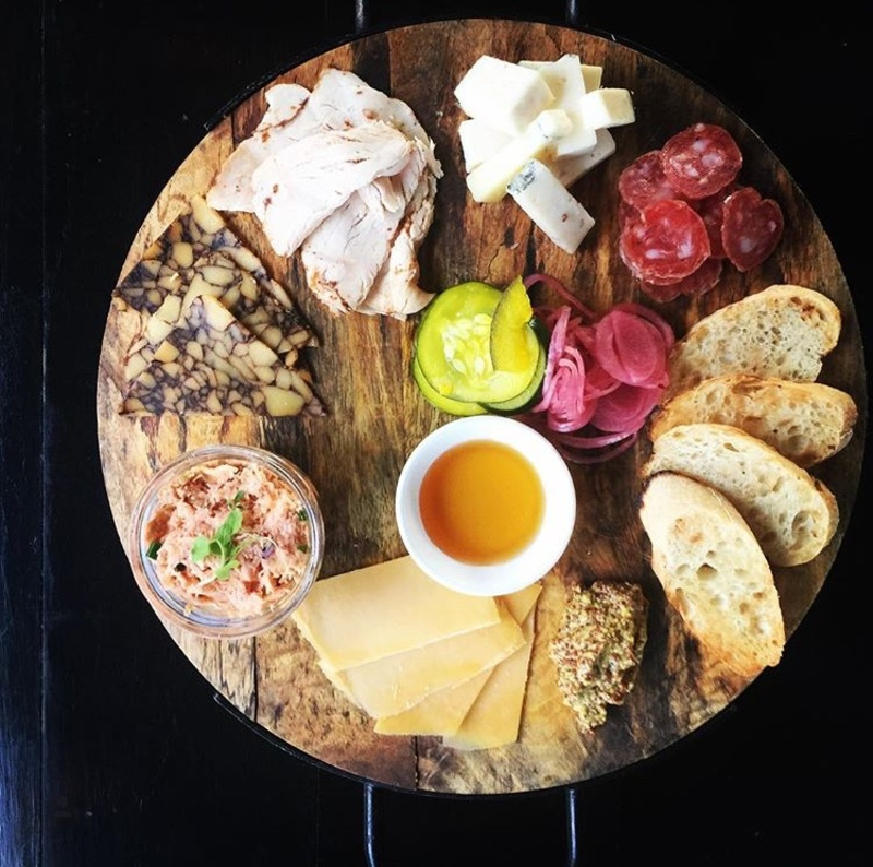 Chef's Board tonight featured, chorizo, Cajun turkey, smoke salmon rilette, porter cheddar, mobey cheese, manchego cheese, local honey, traditional baguette, house pickles and pickled onions