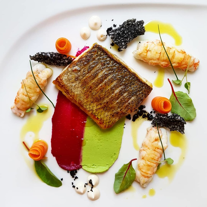 Grilled sea bass•butter poached and torched langoustine•beetroot/pea puree•carrot•lemon mayo•spicy olive oil...