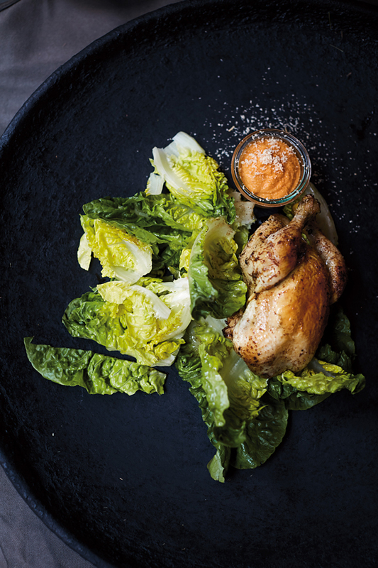 Roast chicken with mojo rojo, almonds and fried lettuce by Niklas Ekstedt