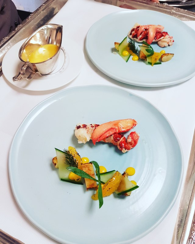 Herb butter poached lobster, sauce americane