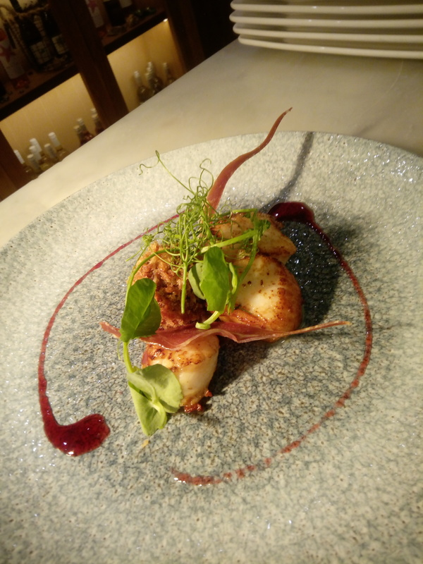 Seared scallops haggis bon bon red wine syrup parmaham crisp bacon crumb