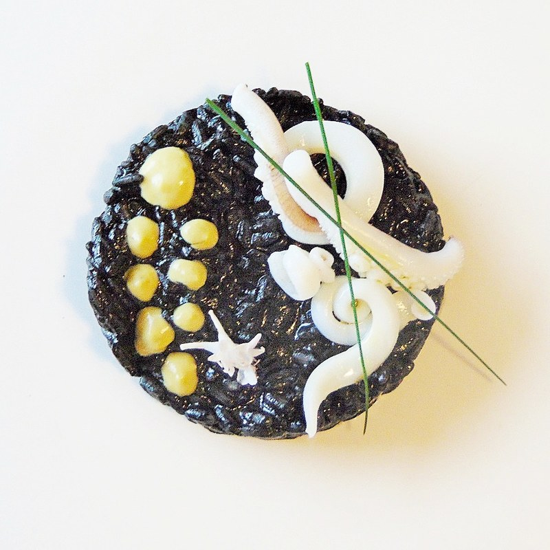 Carnaroli rice / cuttlefish ink / yogurt cream and fresh peas / sour cuttlefish / chives