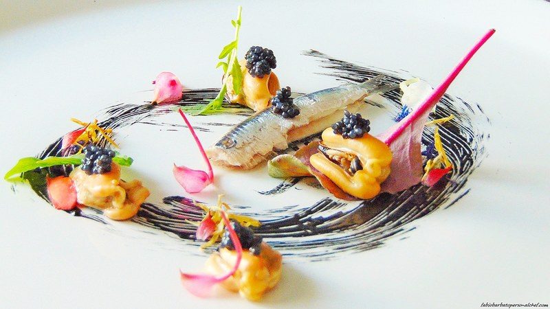 Anchovy / mussels / caviar / mayonnaise with cuttlefish ink / dried marigold flowers / buds