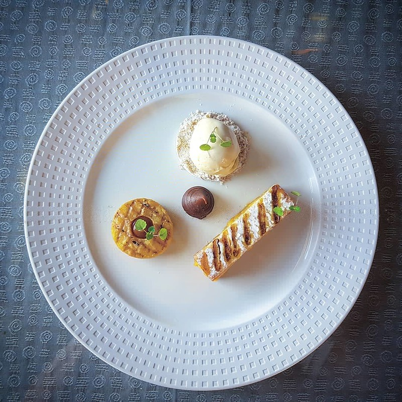 Flavours of toffee apple. Toffee poached and grilled granny Smith, warm toffee apple bread pudding, crisp puff pastry, salt caramel powder, vanilla ice cream.