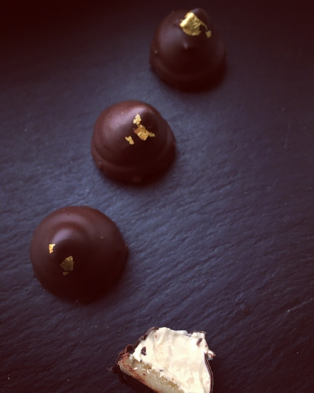 DANISH FLOEDEBOLLE WITH CALAMANSI: ... ... An Italian meringue infused with Calamansi juice from the Philippines. Piped onto an Argentinian marzipan base, & dipped in Colombian dark chocolate. Finished with 24 carat gold leaf.