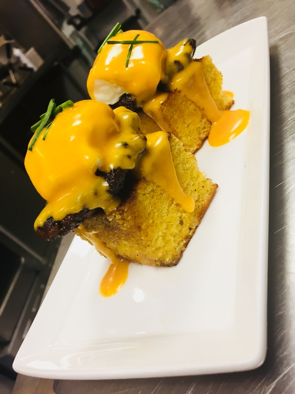 Egg's Benedict , Corn bread, house made chorizo, spicy hollandaise