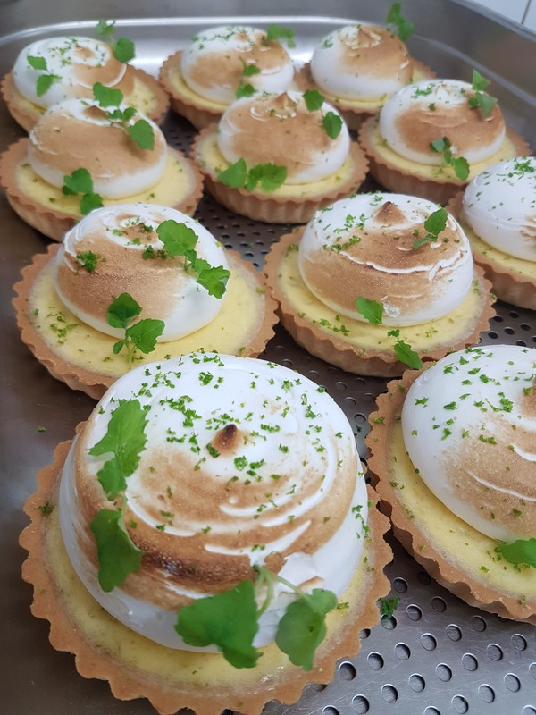 Lime meringue tarts. Served with Crystallized dark chocolate and line sorbet