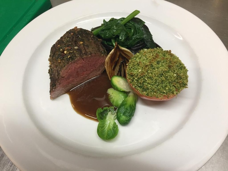 Spiced Rump cap, spinach and beetroot leaves. Charred onion, busselsprouts, herb crusted blanch tomatoe, chilean mushroom demi.