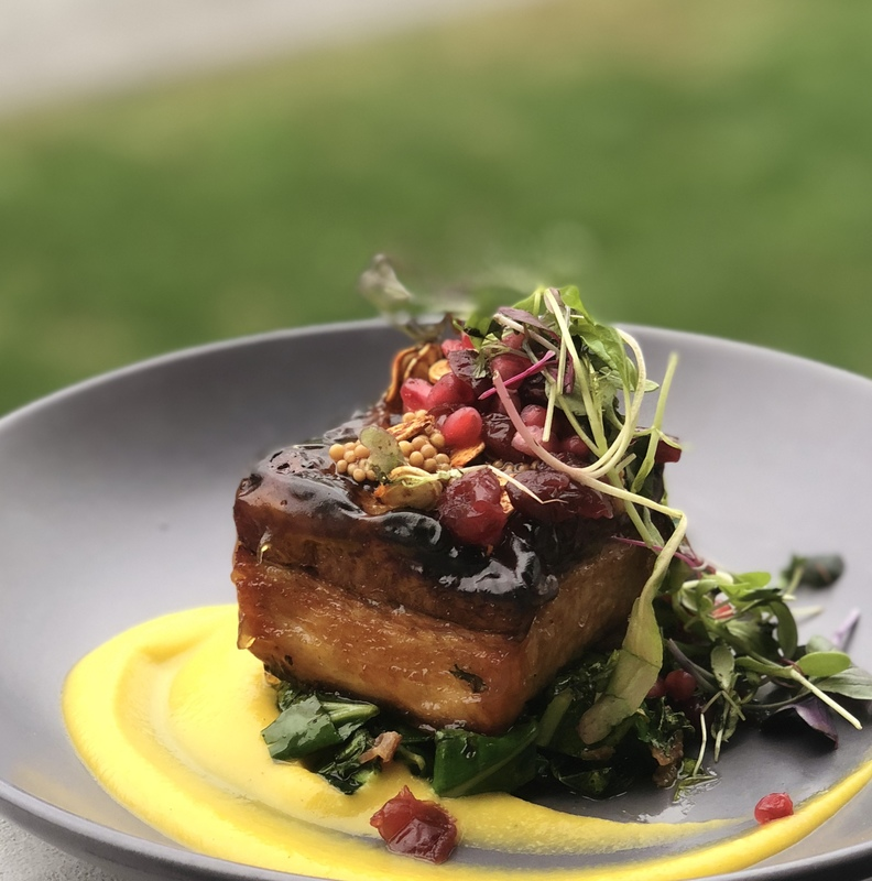 Crispy pork belly, maple Dijon, collards, pomegranate, pumpkin