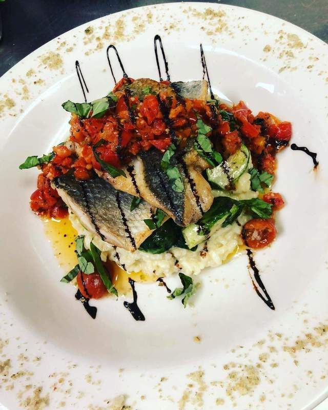 Bronzini, parmesan risotto, sauteed brussel sprouts, marinated tomatoes