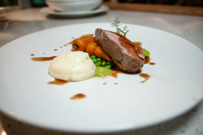 Sous vide lamb • Smoked potato • Chantenay butter confit • Pea puree • Sloe jus