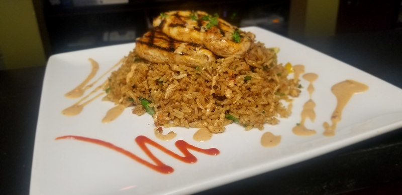Cajun grilled swordfish over an Asian dirty fried rice