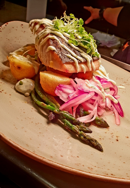 Blue eye cod with buttered asparagus tumerac chats pickled onion and dill aioli garnished with micro lemon and mine