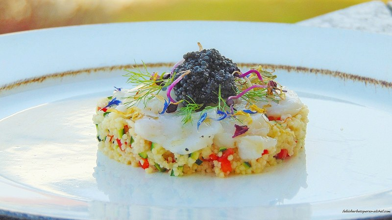 Sogno di una notte di mezza estate Cous cous /Mirepoix of red peppers and courgettes /Scallop carpaccio /Sturgeon eggs /Wild fennel /Radish sprouts /dried edible flowers