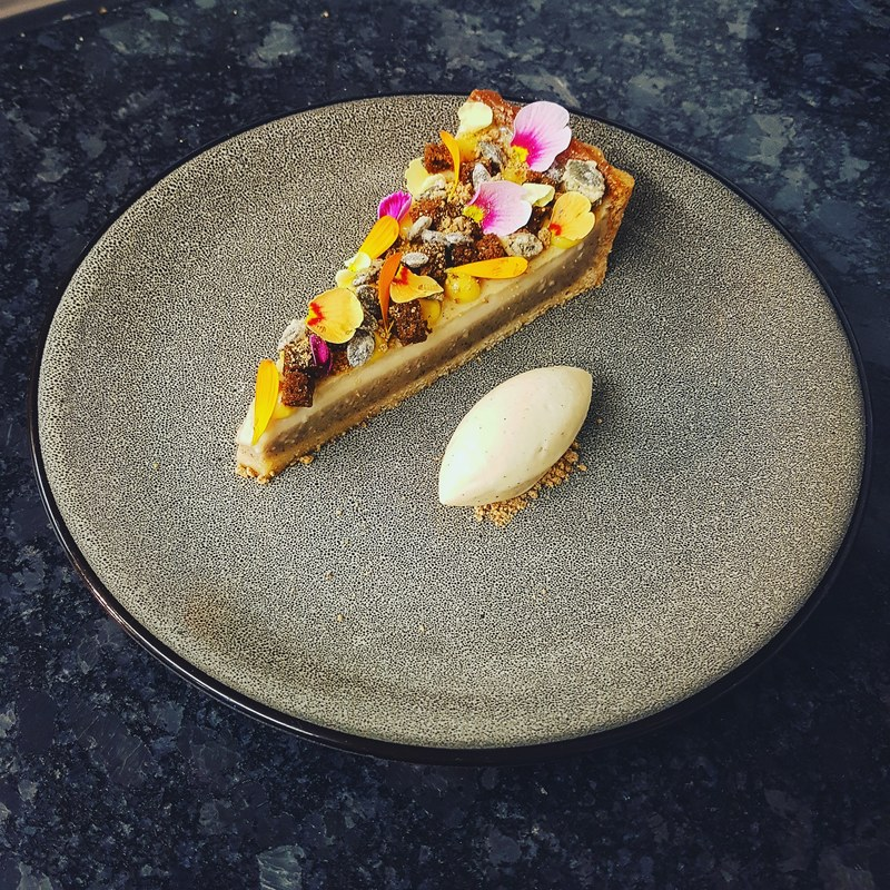 Spiced pumpkin custard tart, gingerbread sponge, candied pumpkin seeds and gingerbread ice cream.