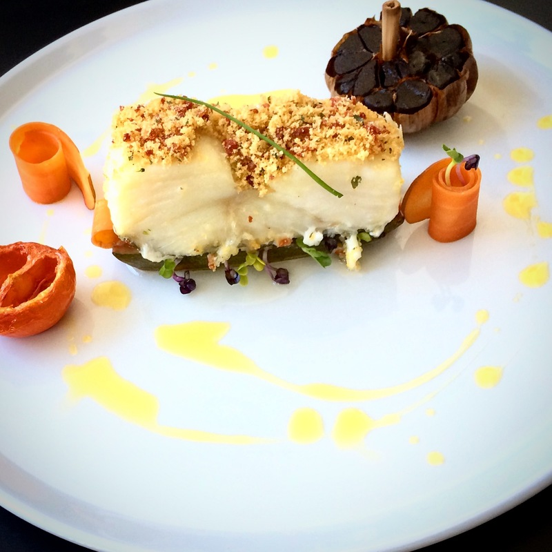 baked cod, chorizo ​​crust, bread crumbs, courgette and tomato confit, carrot, sprouted radish, alfalfa, black garlic, tarragon oil