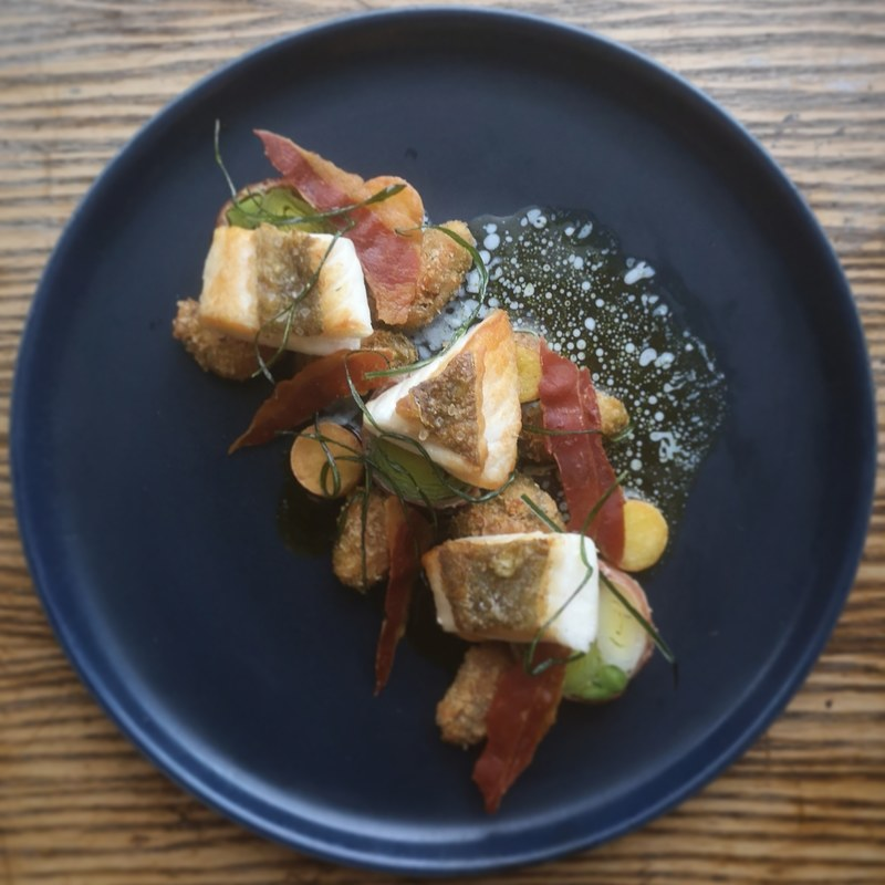 John dory, crispy garlic mussels, leeks wrapped in Parma ham, chive and buttermilk dressing.
