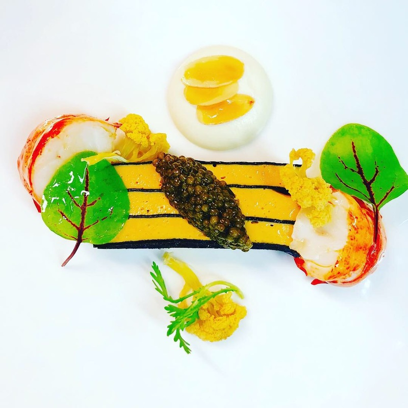 Lobster, sea urchin, squid ink crepes, cauliflower, caviar, almonds