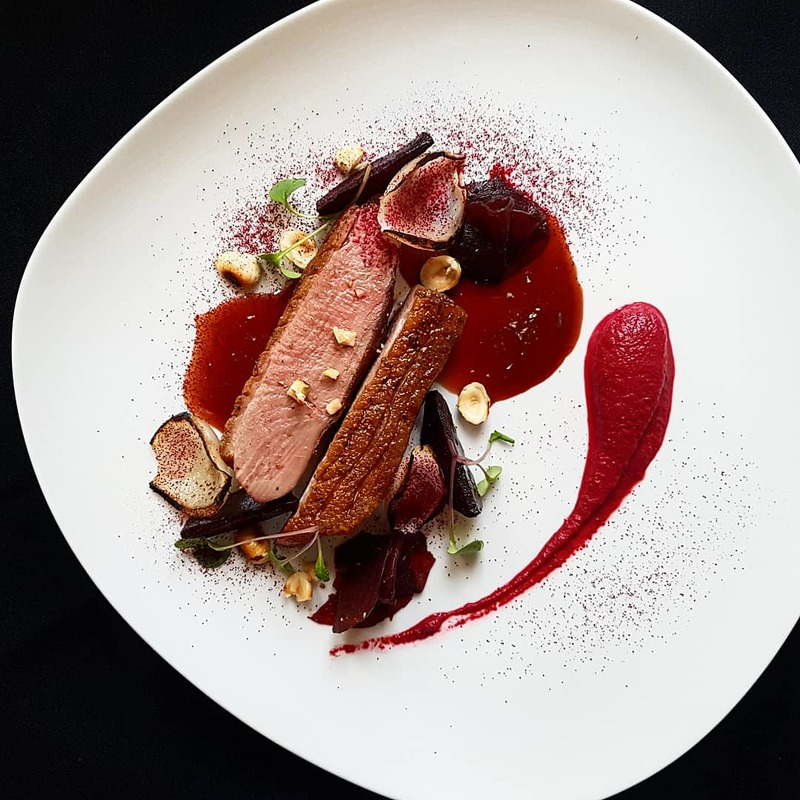 Wood roasted duck breast•juniper duck sauce•beetroot×4/pureed,oven baked,pickled and powder•onion petals•hazelnut.... CLOSE UP!